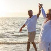 retired walking on the beach